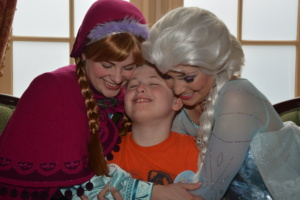 Brandon V. with Anna and Elsa from Frozen.