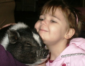 Hunter M. and her Special Gift of a pot belly pig!