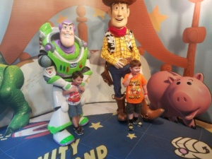 Jaxon M. and his brother, Jasper, meet Buzz and Woody!