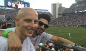 Ryad E. at soccer game with friend